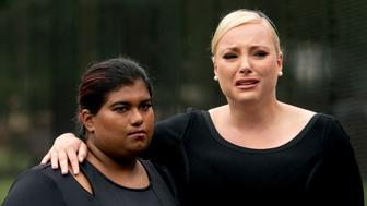 Bridget McCain and Meghan McCain, daughters of, Sen. John McCain, R-Ariz., watch as Cindy McCain, lays a wreath at the Vietnam Veterans Memorial in Washington, Saturday, Sept. 1, 2018, during a funeral procession to carry the casket of her husband from the U.S. Capitol to National Cathedral for a Memorial Service. McCain served as a Navy pilot during the Vietnam War and was a prisoner of war for more than five years. (AP Photo/Andrew Harnik, Pool)