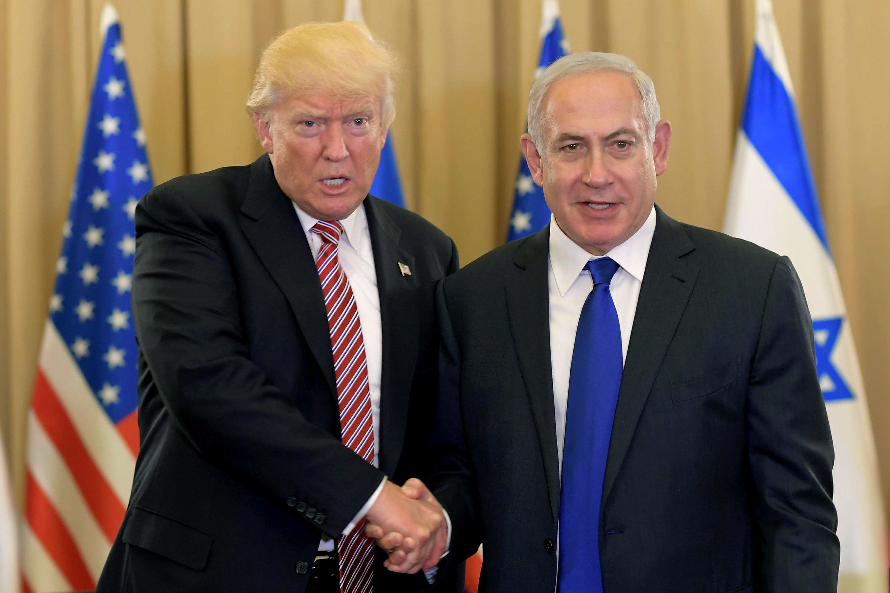 JERUSALEM, ISRAEL - MAY 22:  (ISRAEL OUT) In this handout photo provided by the Israel Government Press Office (GPO), US President Donald J Trump (L) meets with Israel Prime Minister Benjamin Netanyahu at the King David Hotel May 22, 2017 in Jerusalem, Israel. Trump arrived for a 28-hour visit to Israel and the Palestinian Authority areas on his first foreign trip since taking office in January.  (Photo by Amos Ben Gershom/GPO via Getty Images)