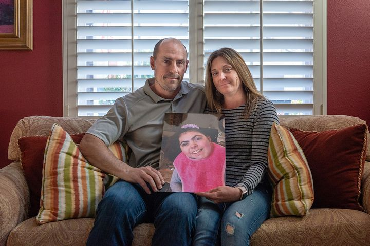 Bobby and Tara Dilliplaine hold a photo of daughter Brooke, who suffered complications when she was given medication she was