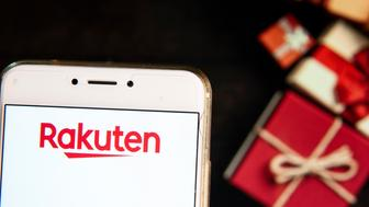 HONG KONG - 2018/11/21: Japanese electronic commerce and Internet company Rakuten company logo is seen on an Android mobile device with a Christmas wrapped gifts in the background. (Photo by Miguel Candela/SOPA Images/LightRocket via Getty Images)