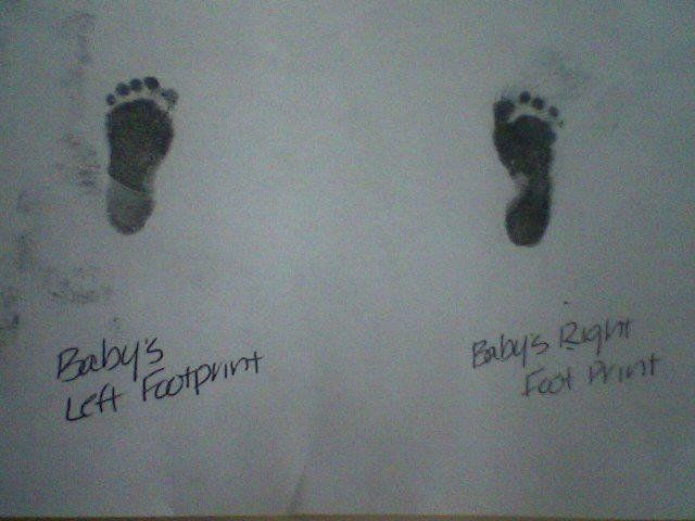 Azlend's tiny footprints, taken just after his birth.