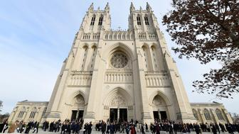 People mingle outside following the State Funeral for former President George H.W. Bush at the National Cathedral in Washington, Wednesday, Dec. 5, 2018. (AP Photo/Susan Walsh)