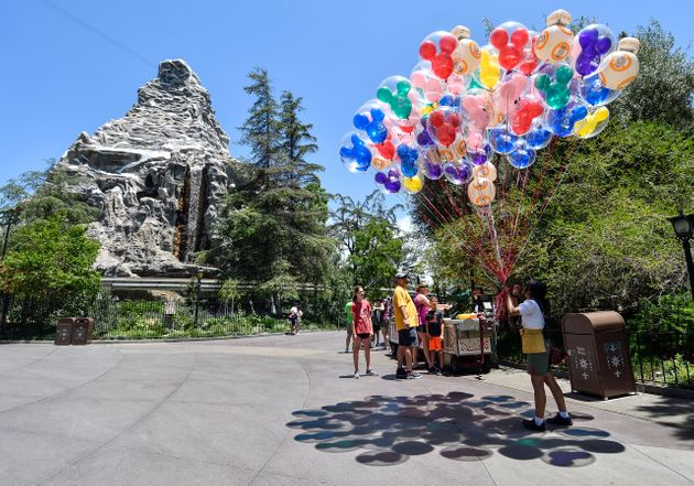 Mickey-shaped balloons are among the popular souvenirs at the Disney