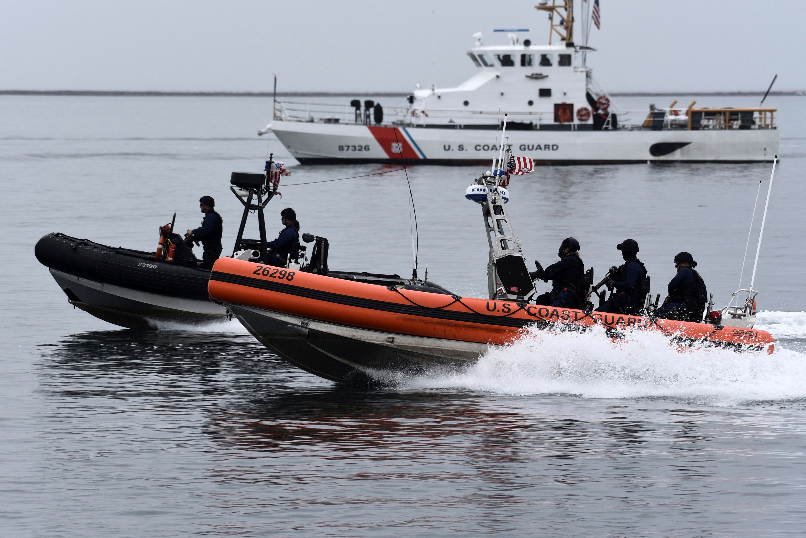 U.S. Coast Guard Maritime Security Response Team-West crew members conduct a tactical demonstration in the Port of Los Angeles, Thursday, March 21, 2019. Strapped with an aging fleet, the U.S. Coast Guard is about to award a contract for a much-needed new icebreaker to help compete against Russia and China for a presence in the Arctic, but the service needs more funding for operations and infrastructure, its commandant said Thursday. (Seaman Ryan Estrada/U.S. Coast Guard via AP)
