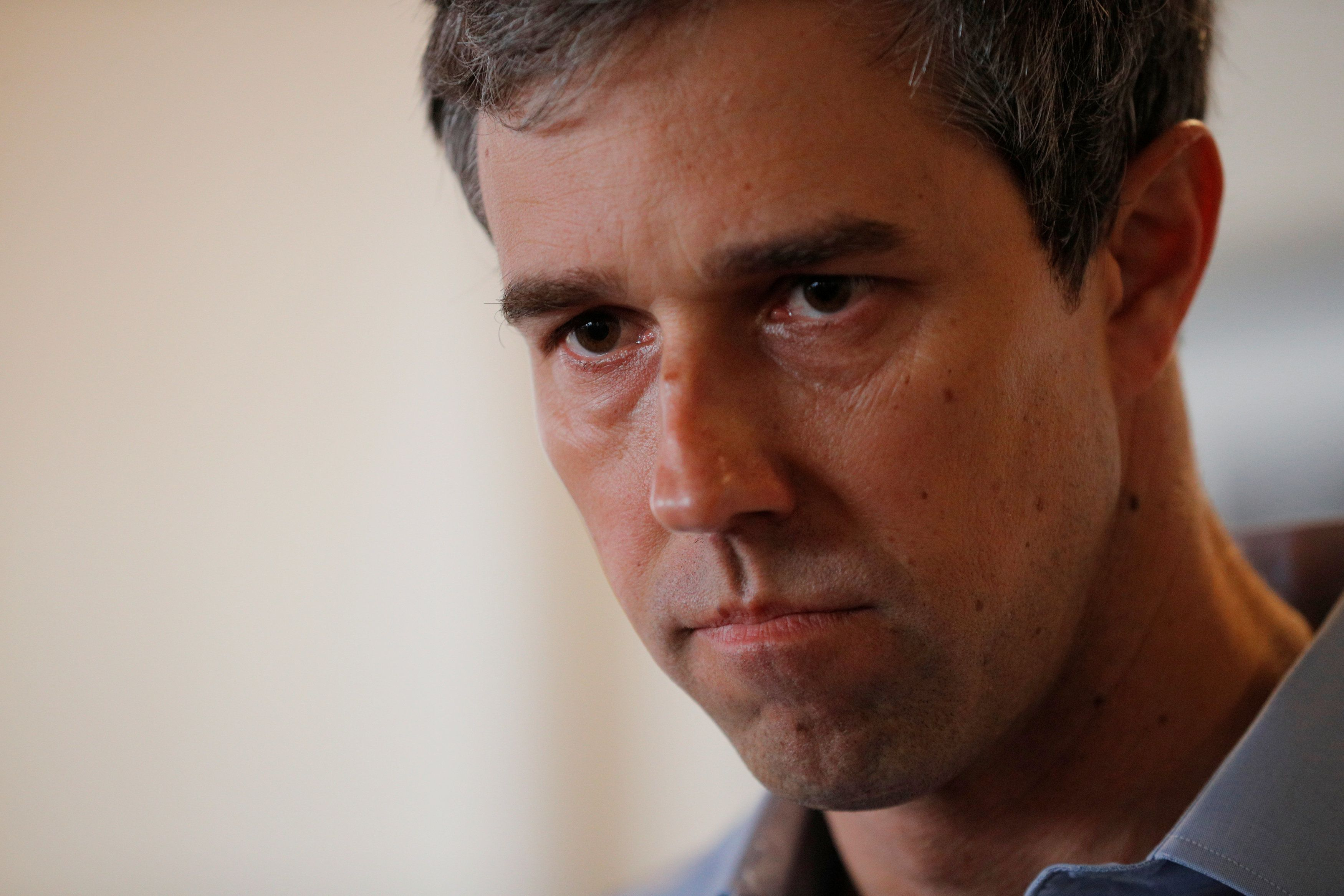 Democratic 2020 U.S. presidential candidate and former U.S. Representative Beto O'Rourke listens to a question from the audience during a campaign stop at Popovers Bakery and Cafe in Portsmouth, New Hampshire, U.S., March 21, 2019.   REUTERS/Brian Snyder