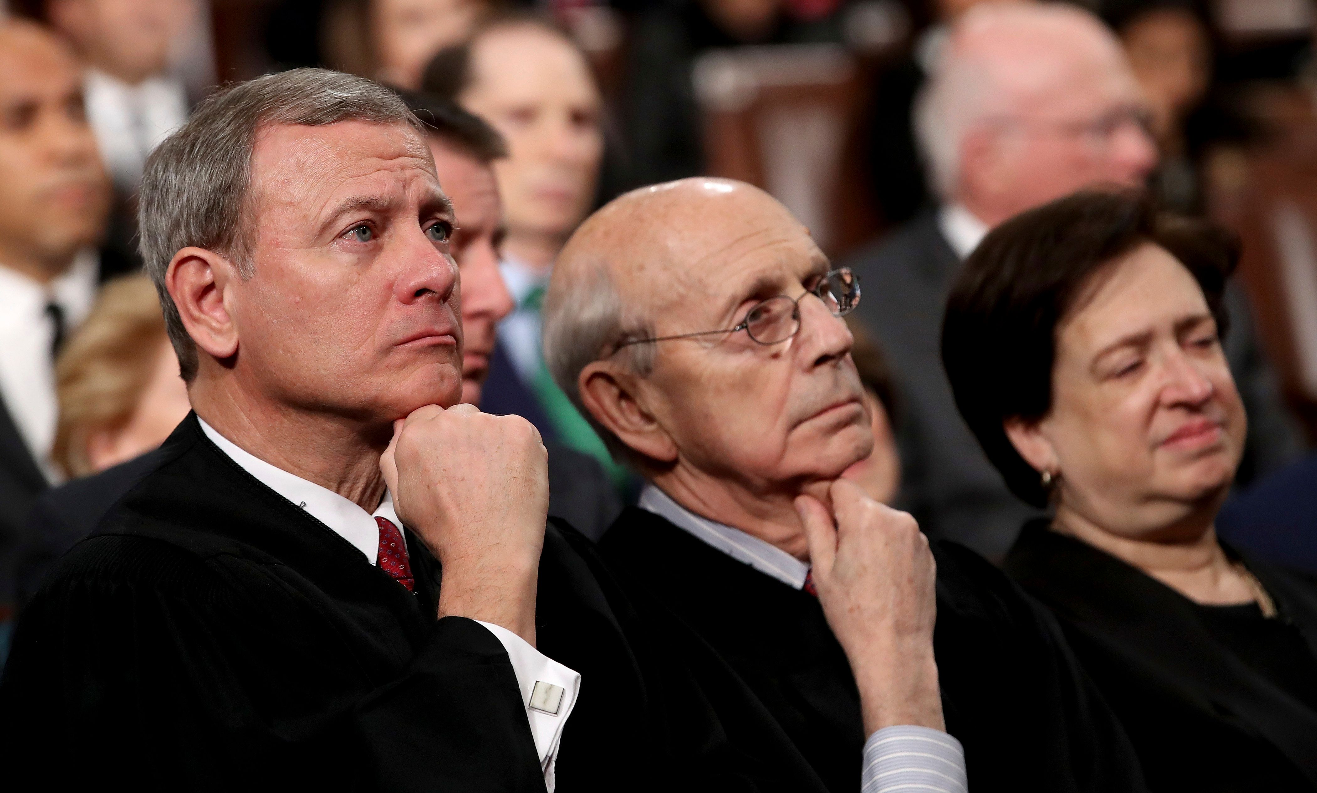 U.S. Supreme Court Chief Justice John Roberts, from left, Associate Justice Stephen Breyer, and Associate Justice Elena Kagan listens as President Donald Trump delivers his first State of the Union address in the House chamber of the U.S. Capitol to a joint session of Congress Tuesday, Jan. 30, 2018 in Washington. (Win McNamee/Pool via AP)