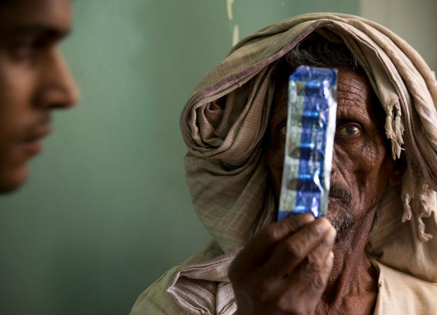 A tuberculosis patient holds medicines at the Lal Bahadur Shastri Government Hospital at Ram Nagar in...