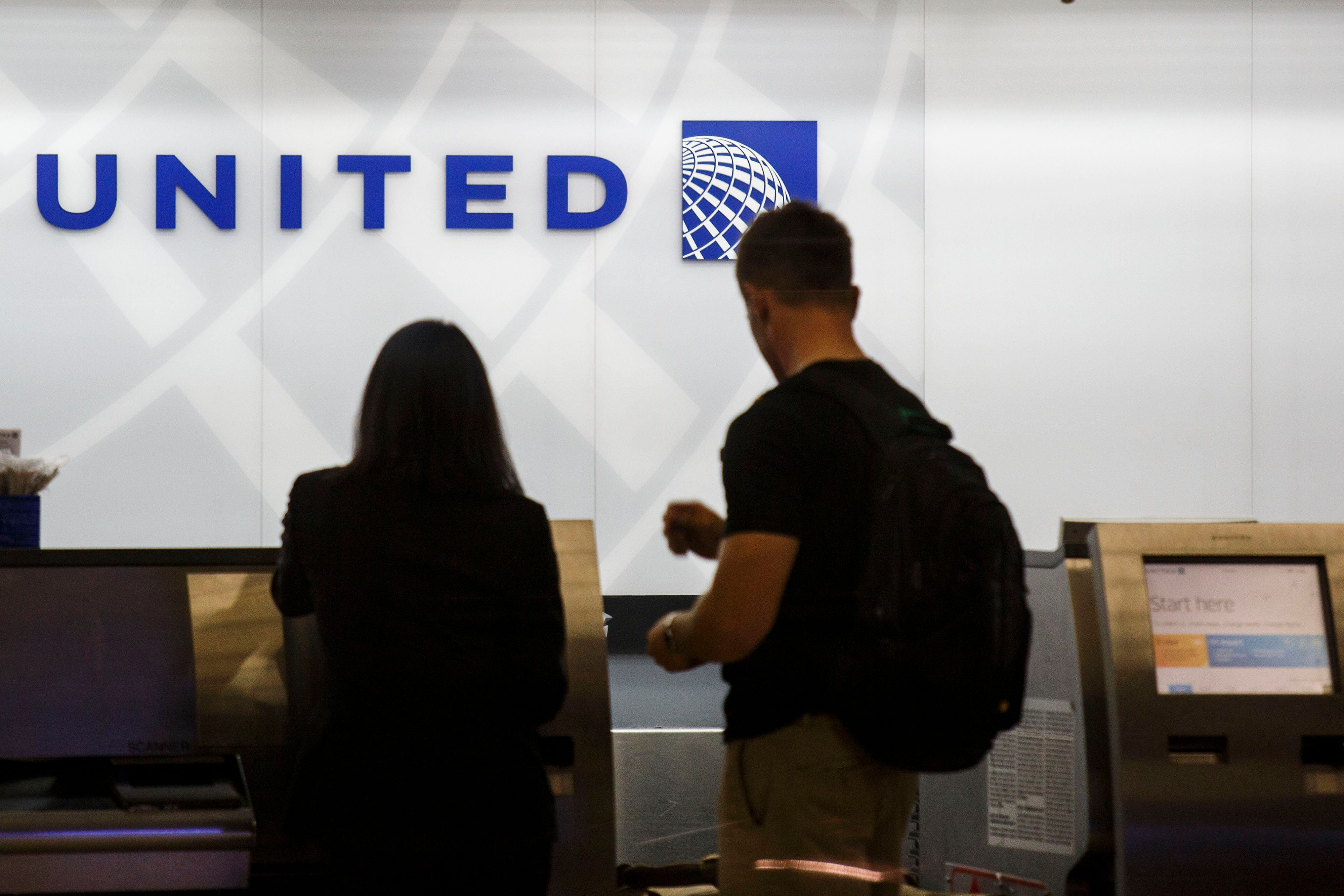 Passengers check-in for flights at United Continental Holdings Inc. Terminal 7 of Los Angeles International Airport (LAX) in Los Angeles, California, U.S., on Tuesday, Aug. 18, 2015. LAX is one of a handful of major U.S. airports where no one carrier dominates -- each of the four biggest airlines now holds market share between 14 percent and 18 percent. Photographer: Patrick T. Fallon/Bloomberg via Getty Images