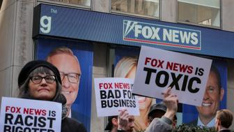 Protesters gather outside of Fox News and the News Corporation building in New York, U.S., March 13, 2019. REUTERS/Brendan McDermid