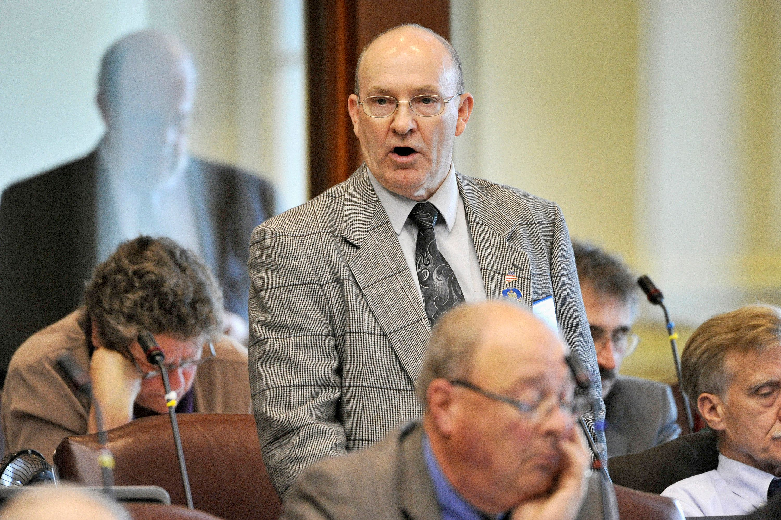 AUGUSTA, ME - JUNE 1, 2015: The Maine House of Representatives discuss a bill before the House which would eliminate the need for a state permit in order to carry a concealed weapon.  Representative Richard Pickett, of Dixfield, spoke in support of the bill which he co-sponsored. (Photo by John Ewing/Portland Press Herald via Getty Images)