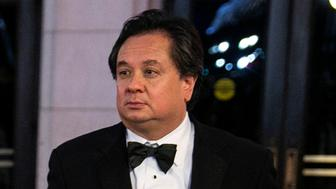 Attorney George Conway, husband of White House Counselor Kellyanne Conway, holds her fur coat as they arrive for a candlelight dinner at Union Station on the eve of the 58th presidential inauguration in Washington, U.S., January 19, 2017. Picture taken January 19, 2017. REUTERS/Joshua Roberts