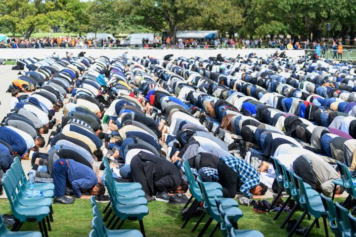 Members of the Muslim community participate in Friday prayers at Hagley Park, near Al Noor mosque, on March 22, 2019 in Chris