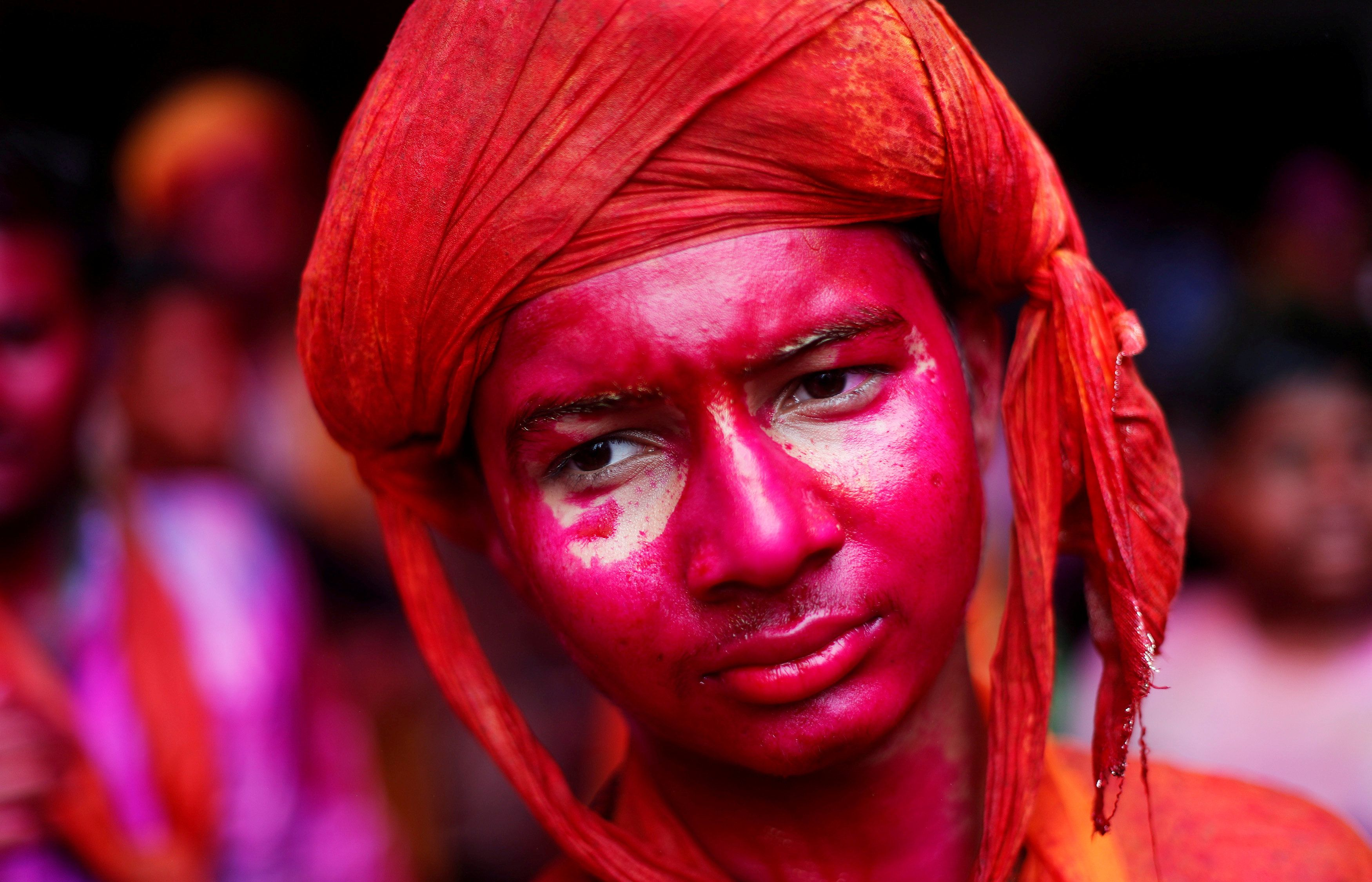 A Hindu devotee takes part in the religious festival of Holi inside a temple in Nandgaon village, in the state of Uttar Pradesh, India, March 16, 2019. REUTERS/Adnan Abidi     TPX IMAGES OF THE DAY