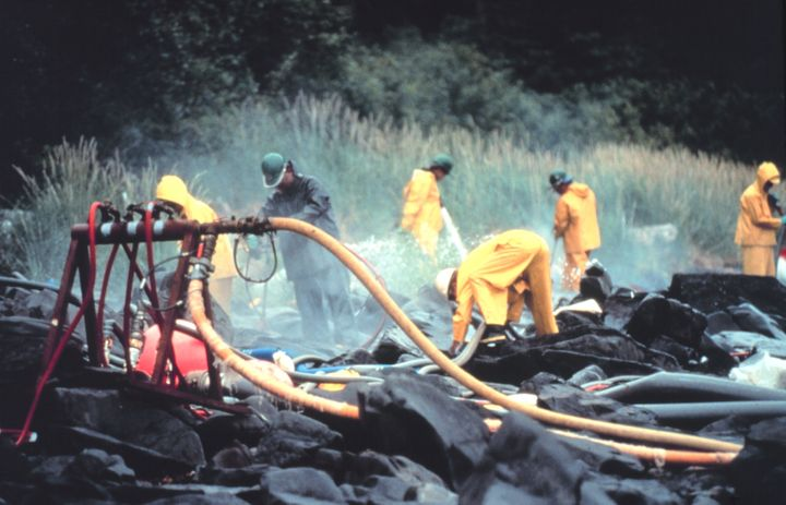 Pressure cleaning rocks in the aftermath of the spill near Prince William Sound, Alaska.