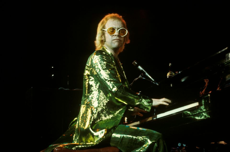 Elton John onstage in a sequined suit.