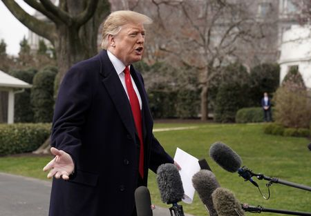U.S. President Donald Trump talks to reporters as he departs on travel to Ohio from the White House in Washington, U.S., March 20, 2019. REUTERS/Kevin Lamarque