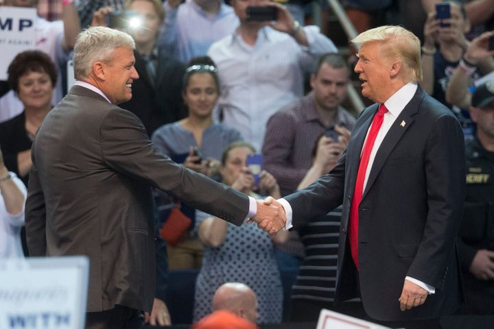Buffalo Bills head coach Rex Ryan shakes hands with Donald Trump after introducing him during a campaign stop in Buffalo, New