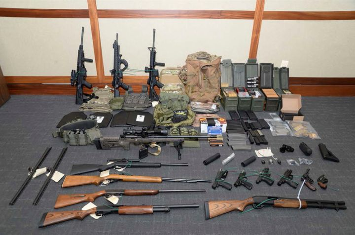 This image provided by the U.S. District Court in Maryland shows a photo of firearms and ammunition that was in the motion fo