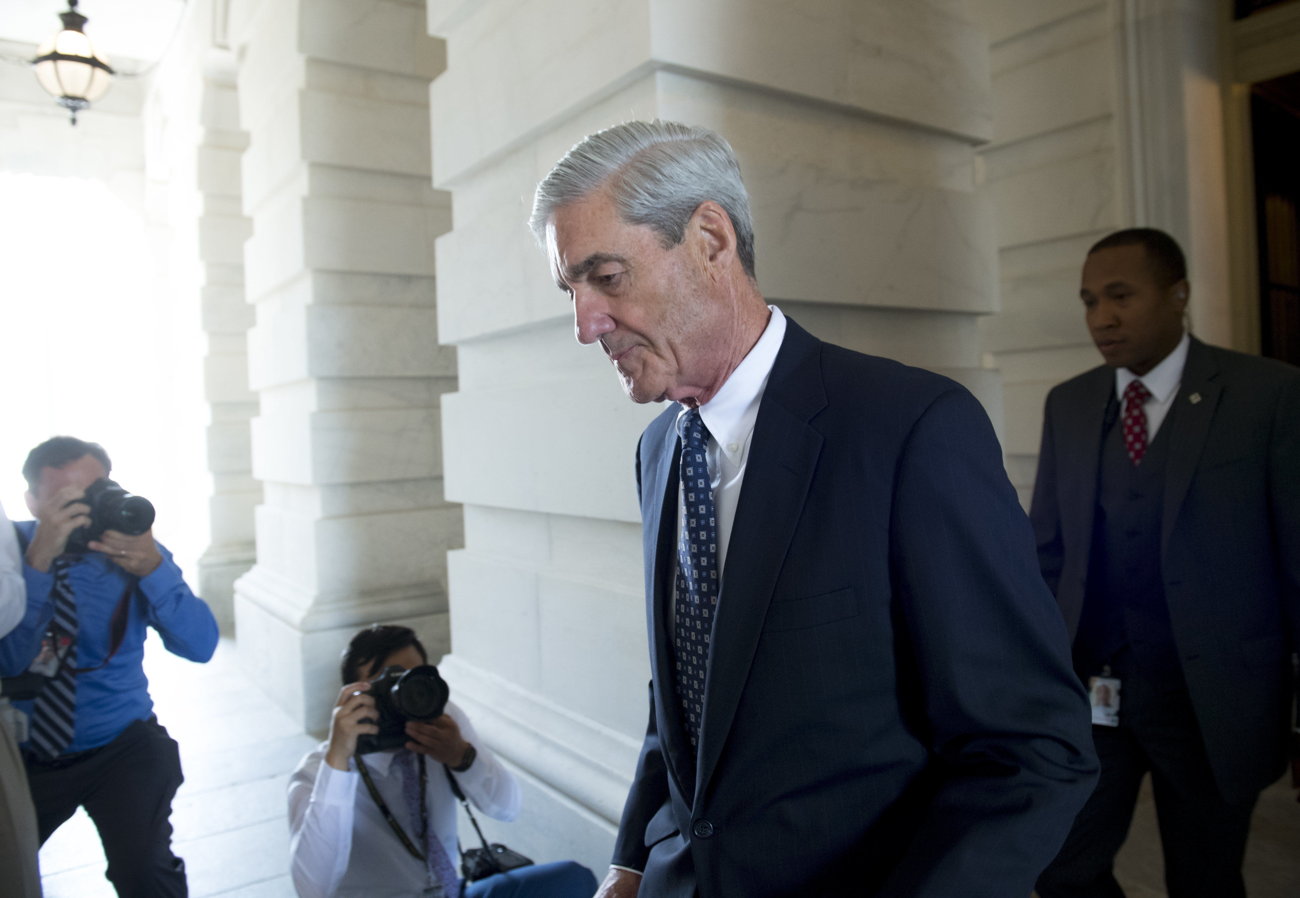 Former FBI Director Robert Mueller, special counsel on the Russian investigation, leaves following a meeting with members of the US Senate Judiciary Committee at the US Capitol in Washington, DC on June 21, 2017. / AFP PHOTO / SAUL LOEB        (Photo credit should read SAUL LOEB/AFP/Getty Images)