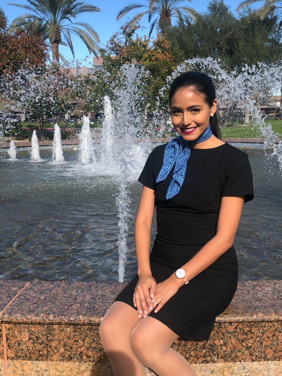 In a photo taken by her husband, SeleneSaavedraRoman wears her flight attendant uniform.