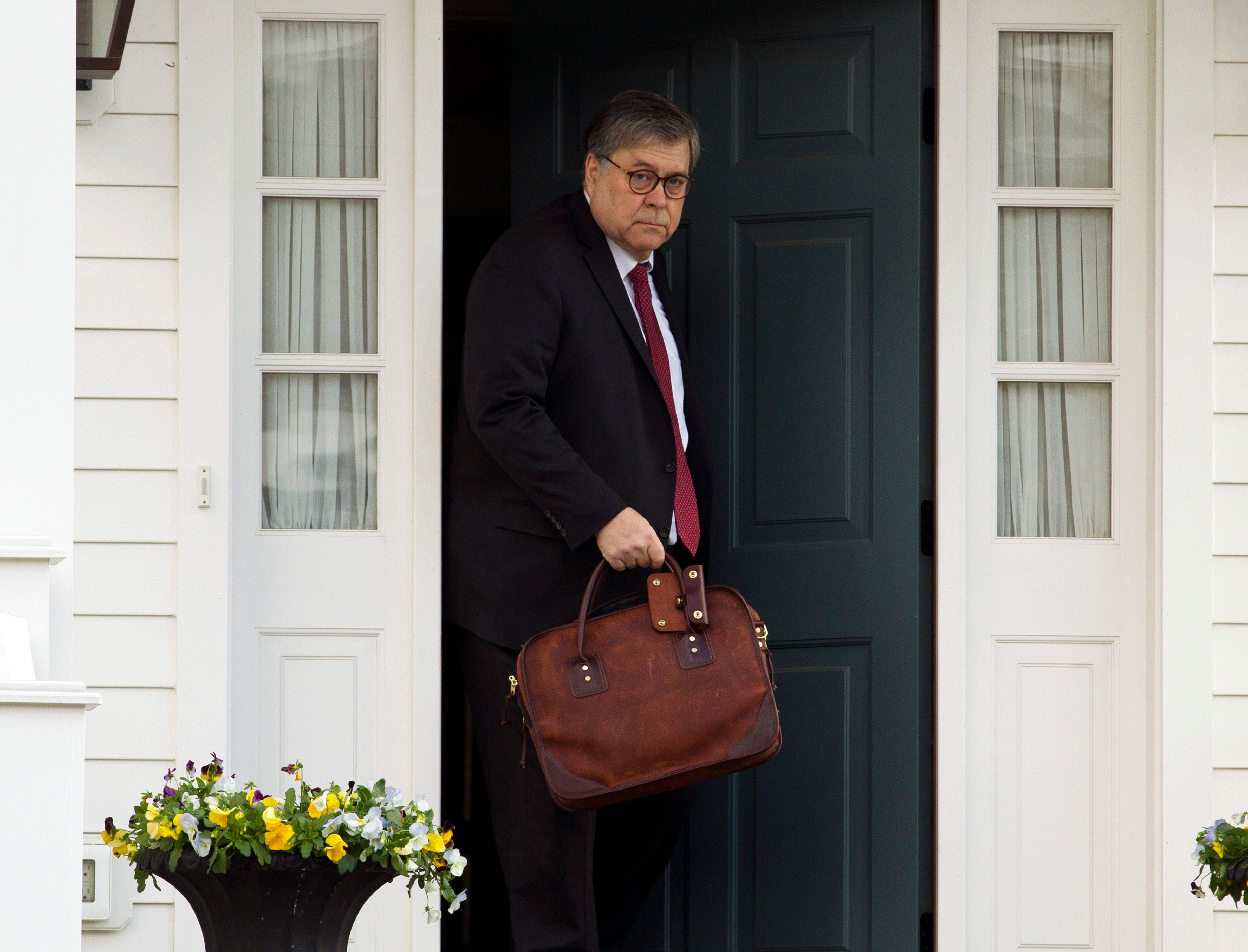 Attorney General William Barr leaves his home in McLean, Va., on Friday, March 22, 2019. Special Counsel Robert Mueller is expected to present a report to the Justice Department any day now outlining the findings of his nearly two-year investigation into Russian election meddling, possible collusion with Trump campaign officials and possible obstruction of justice by Trump . (AP Photo/Jose Luis Magana)