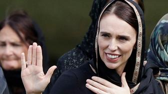 New Zealand Prime Minister Jacinda Ardern, second right, waves as she leaves Friday prayers at Hagley Park in Christchurch, New Zealand, Friday, March 22, 2019. People across New Zealand are observing the Muslim call to prayer as the nation reflects on the moment one week ago when 50 people were slaughtered at two mosques. (AP Photo/Mark Baker)