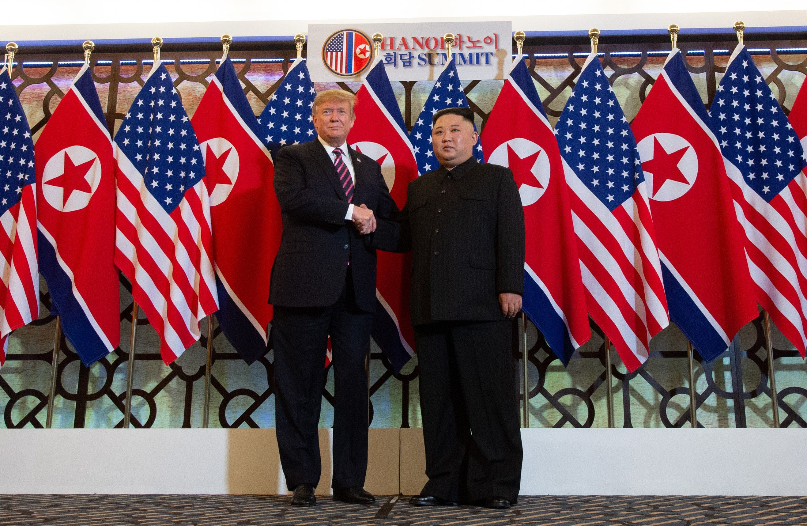 TOPSHOT - US President Donald Trump (L) shakes hands with North Korea's leader Kim Jong Un before a meeting at the Sofitel Legend Metropole hotel in Hanoi on February 27, 2019. (Photo by Saul LOEB / AFP)        (Photo credit should read SAUL LOEB/AFP/Getty Images)