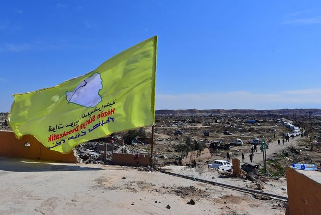 A picture taken on March 23, 2019 shows the US-backed Syrian Democratic Forces' (SDF) flag atop a building...