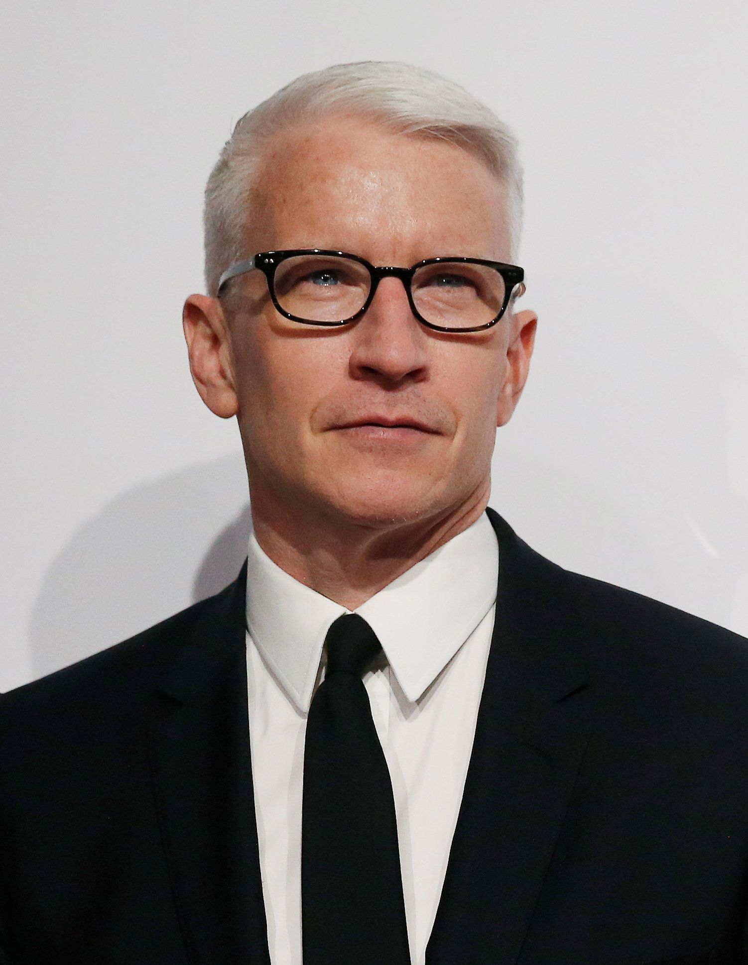Anderson Cooper poses on the red carpet at the Billboard Magazine's 11th annual Women in Music luncheon in New York December 9, 2016.  REUTERS/Shannon Stapleton