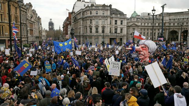 An effigy of British Prime Minister Theresa May is wheeled through Trafalgar Square during a Peoples Vote anti-Brexit march in London, Saturday, March 23, 2019. The march, organized by the People's Vote campaign is calling for a final vote on any proposed Brexit deal. This week the EU has granted Britain's Prime Minister Theresa May a delay to the Brexit process. (AP Photo/Tim Ireland)