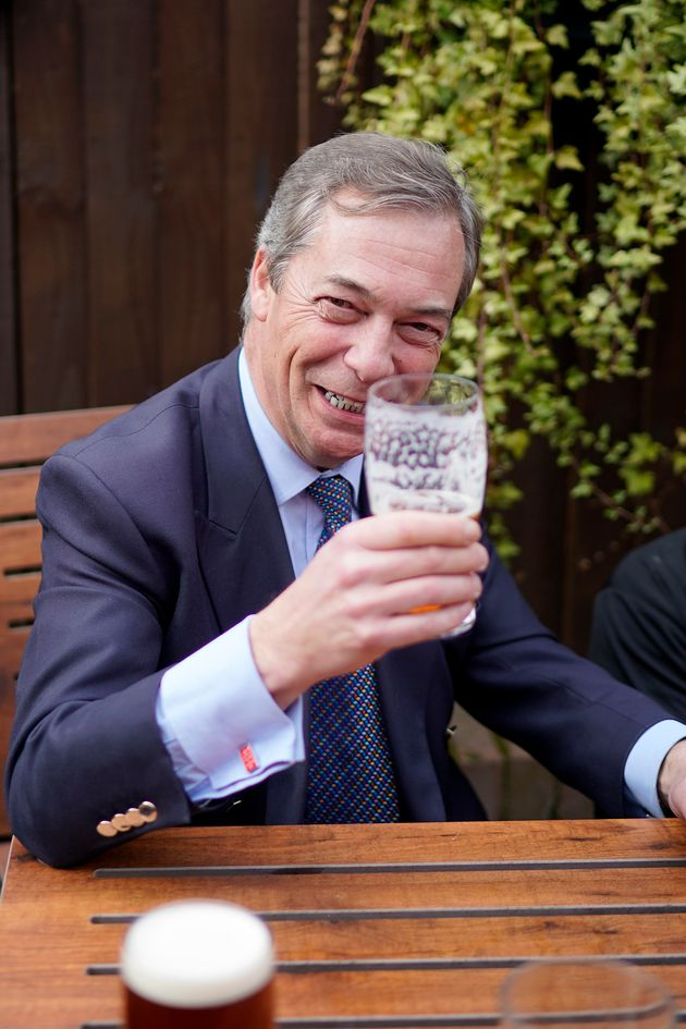 Farage wears 'Keep Calm and Carry ON' cufflinks as he drinks a pint of beer at the Last Post pub at the...