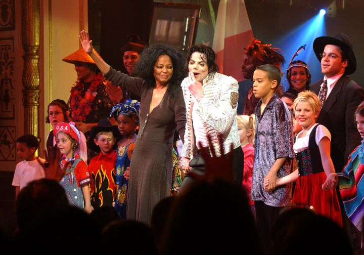 Diana Ross and Michael Jackson perform at a charity benefit.