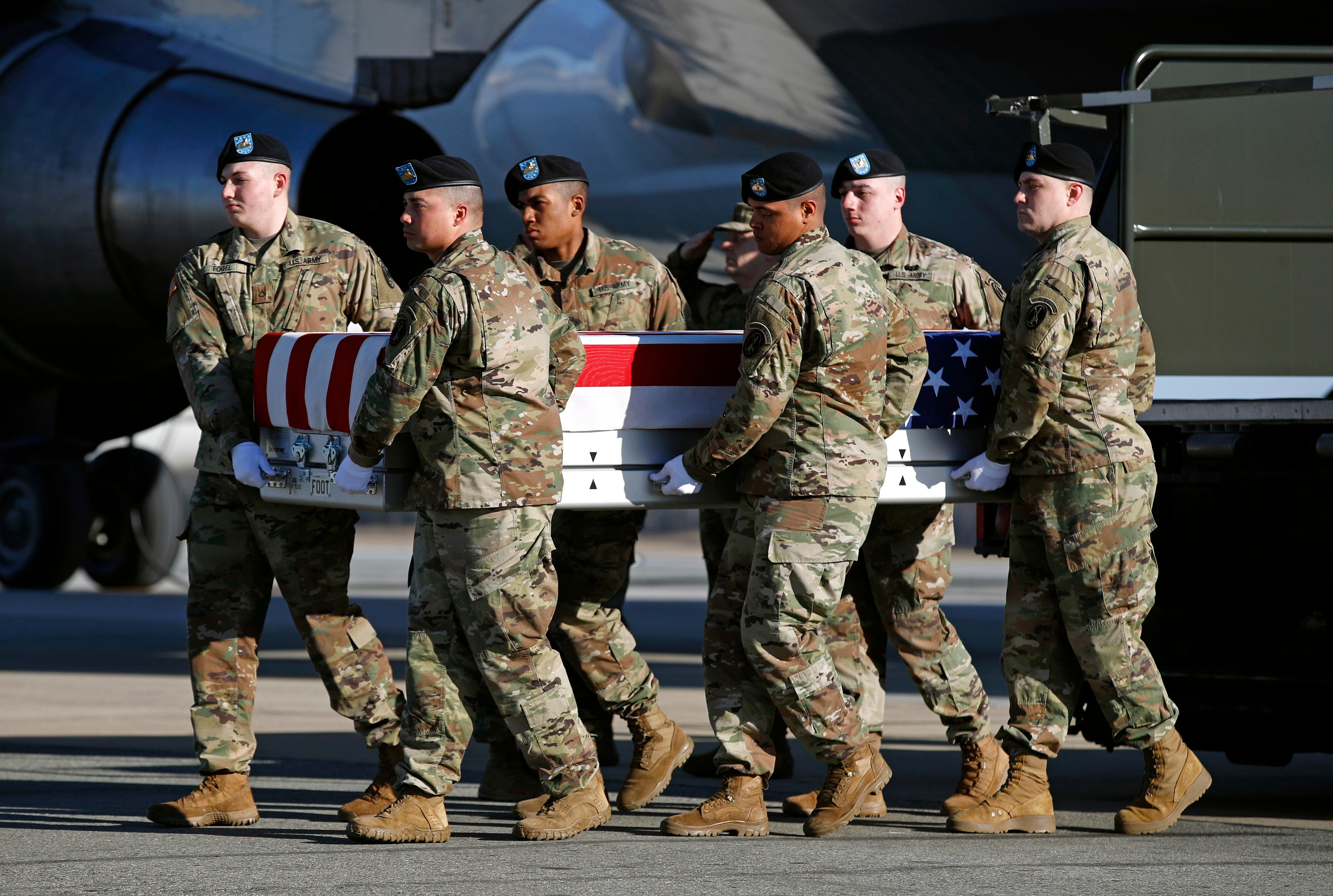A U.S. Army carry team moves a transfer case containing the remains of Spc. Joseph P. Collette, Sunday, March 24, 2019, at Dover Air Force Base, Del. According to the Department of Defense, Collette, of Lancaster, Ohio, was killed March 22 while involved in combat operations in Kunduz Province, Afghanistan. (AP Photo/Patrick Semansky)