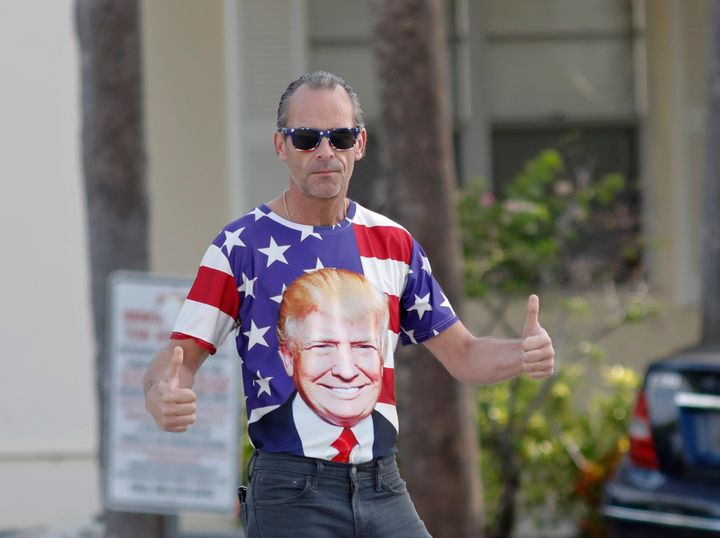 A supporter give a thumbs up before the motorcade carrying President Donald Trump passes by on Sunday, March 24, 2019, in Wes