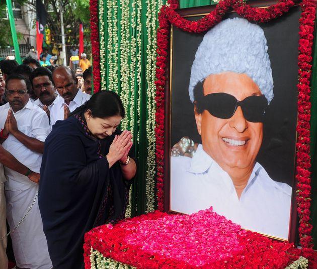 J Jayalalithaa of the All India Anna Dravida Munnetra Kazhagam (AIADMK) visits a portrait of party founder...