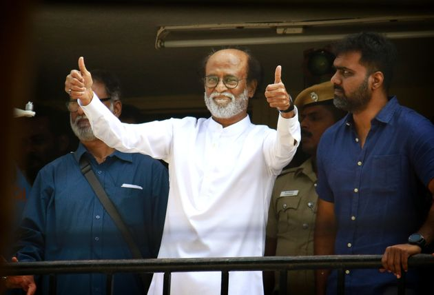 Rajinikanth gives thumbs up sign to his fans after announcement to launch his own political party, in...