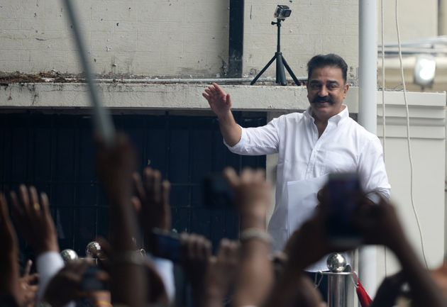 Kamal Hassan gestures as he addresses activists and supporters at his 'Makkal Needhi Mayyam' political...