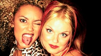 Mel B and Geri Halliwell (Scary and Ginger) of the Spice Girls photographed backstage at the Brit Awards in February 1997.;  (Photo by Ray Burmiston/Photoshot/Getty Images)