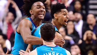 Charlotte Hornets guard Jeremy Lamb, middle, celebrates his game-winning basket against the Toronto Raptors with teammates Devonte' Graham, left, and Frank Kaminsky in an NBA basketball game Sunday, March 24, 2019, in Toronto. (Frank Gunn/The Canadian Press via AP)