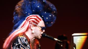 DETROIT - AUGUST 17: English singer, songwriter, pianist and composer, Sir Elton John, performs at Pine Knob Music Thater, on August 17, 1986, in Clarkston, Michigan.  (Photo by Ross Marino/Getty Images)