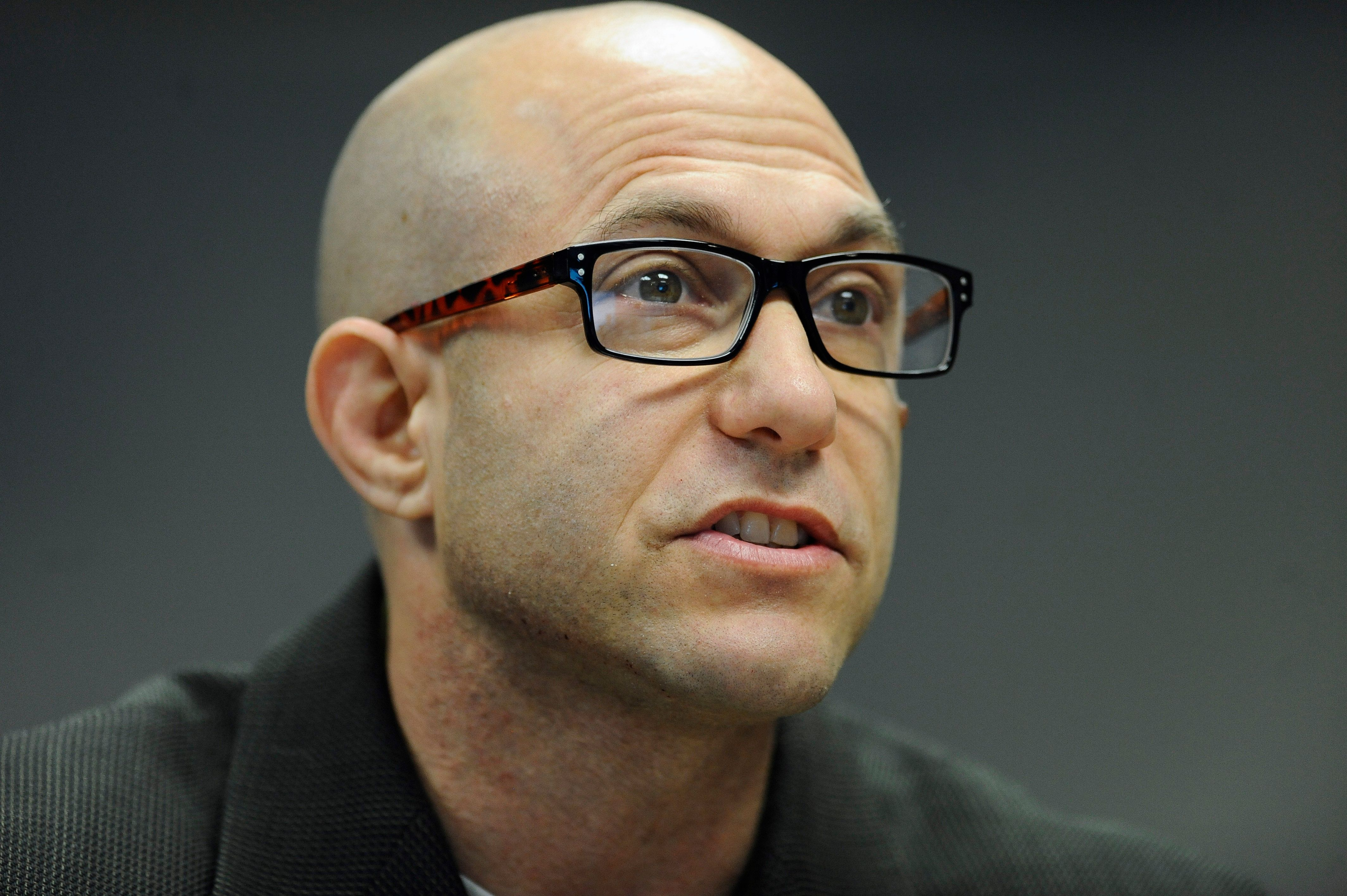 Jeremy Richman father of Sandy Hook Elementary school shooting victim Avielle Richman addresses the Sandy Hook Advisory Commission, Friday, Nov. 14, 2014, in Newtown, Conn. The parents of two children killed made presentations on ways to better address mental health, school safety and gun violence prevention. (AP Photo/Jessica Hill)