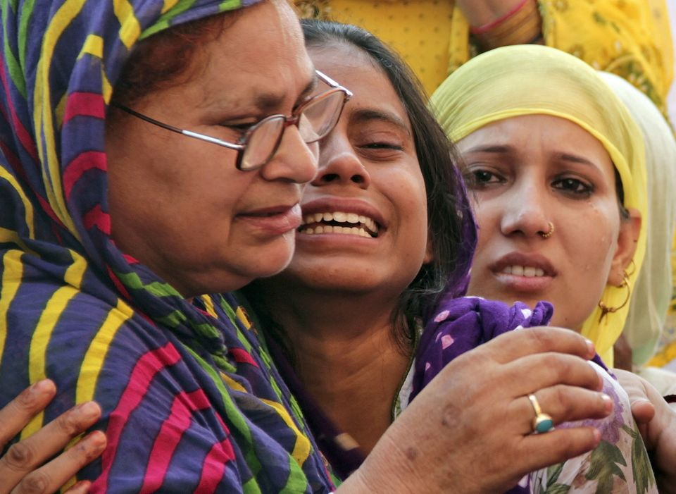 Relatives of Mohammad Akhlaq mourn after he was killed by a mob on 28, September