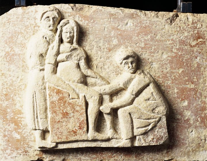 Relief depicting a scene of childbirth from the tomb of Scribonia Attica at the necropolis of Isola Sacra (Sacred Island) in Italy.