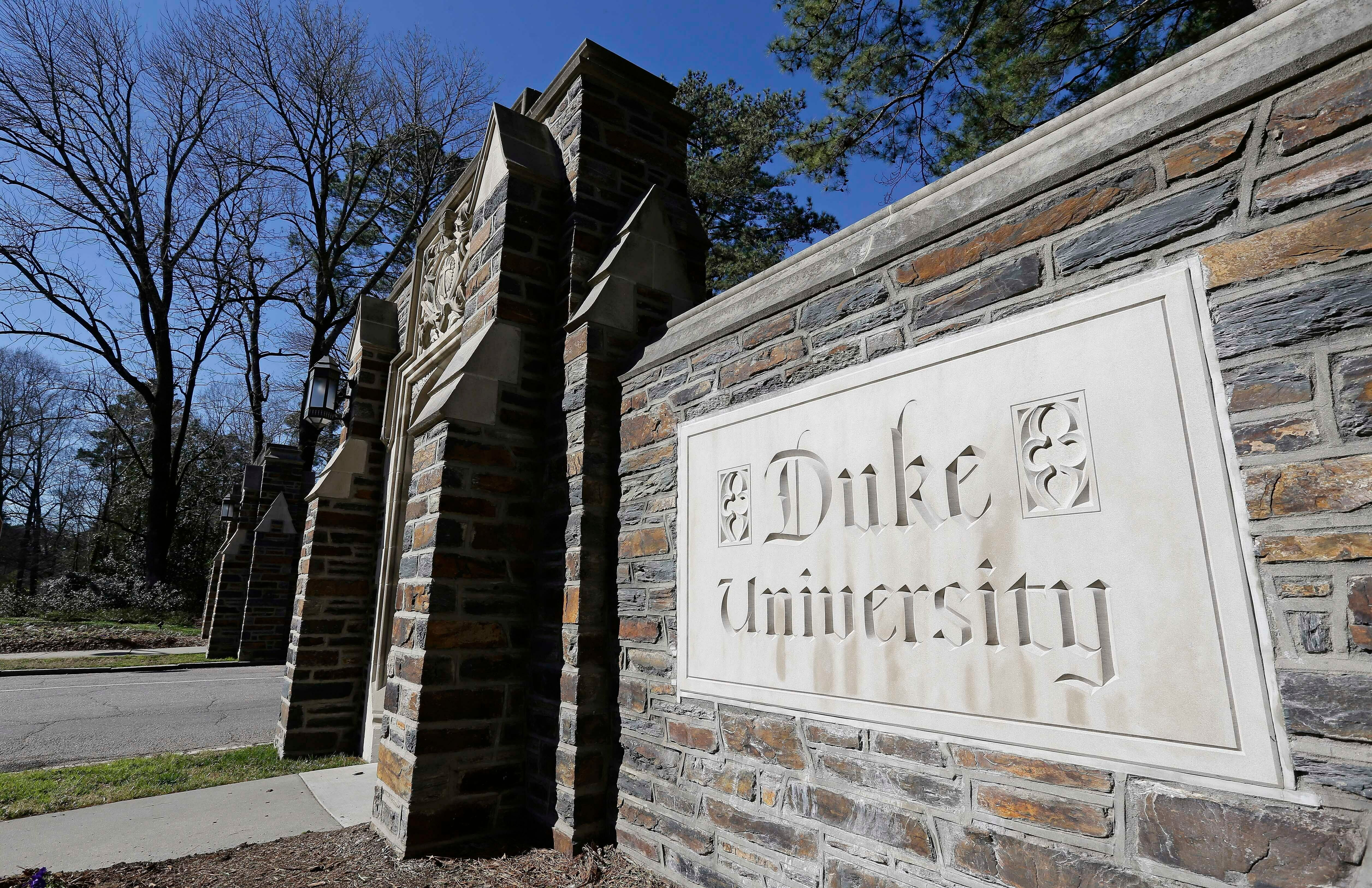 This Jan. 28, 2019 photo shows the entrance to the main Duke University campus in Durham, N.C. The Duke University professor and administrator who sparked an outcry by admonishing students for speaking Chinese has issued a personal apology amid an internal review by the school. (AP Photo/Gerry Broome)
