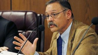 "FILE - In this Nov. 9, 2015, file photo, Arizona state Rep. Mark Finchem, R-Tucson, right, speaks during a Joint Border Security Advisory Committee at the Arizona Capitol as Arizona House Speaker David Gowan, R- Sierra Vista, listens in Phoenix. Backers of a proposal exempting the sale of U.S. gold coins from state capital gains taxes brought in former congressman and presidential candidate Ron Paul on Wednesday, March 8, 2017, to tout their effort at the state Senate. Rep. Mark Finchem's House Bill 2014 is the latest effort to exempt gold coins from taxation. The Oro Valley Republican argues that taxing exchanges of ""legal tender"" like gold coins is a tax on money alone and also is essentially a tax on inflation. (AP Photo/Ross D. Franklin, File)"