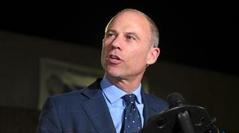 <p> FILE - In this Nov. 14, 2018, file photo, Michael Avenatti speaks to the media outside the Los Angeles Police Department Pacific Division after posting bail for a felony domestic violence charge. U.S. prosecutors announced Monday, March 25, 2019 they have charged Avenatti with extortion and bank and wire fraud. A spokesman for the U.S. attorney in Los Angeles said Avenatti was arrested Monday in New York. (AP Photo/Michael Owen Baker, File)