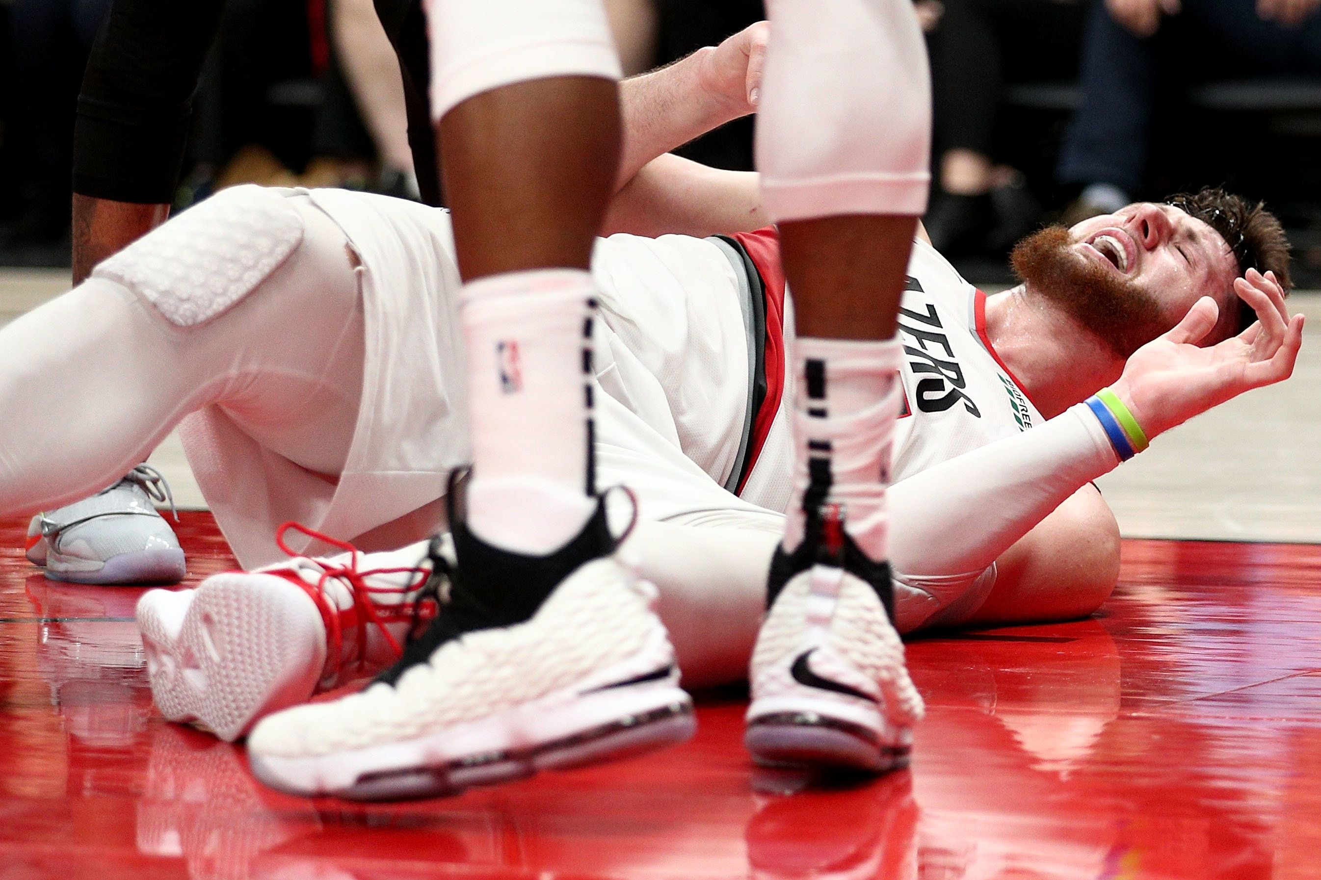 PORTLAND, OR - MARCH 25:  Jusuf Nurkic #27 of the Portland Trail Blazers reacts after suffering an apparent broken leg against the Brooklyn Nets in double overtime during their game at Moda Center on March 25, 2019 in Portland, Oregon. NOTE TO USER: User expressly acknowledges and agrees that, by downloading and or using this photograph, User is consenting to the terms and conditions of the Getty Images License Agreement.  (Photo by Abbie Parr/Getty Images)