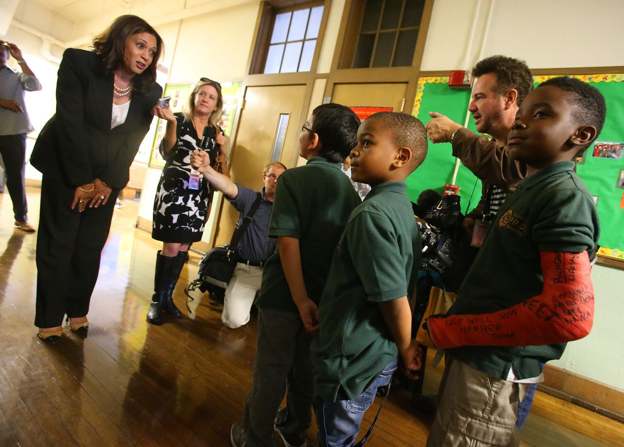 Harris, who was the attorney general for California at the time, talks with students at the East Oakland Pride Elementary School in Oakland on Sept. 4, 2014. She sponsored legislation to help local school districts and communities address California's elementary school truancy crisis.