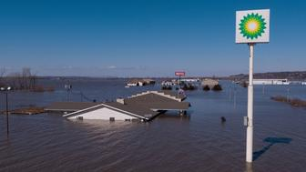 Midwest flooding that has overwhelmed levees and swamped wide swaths of Nebraska, Wisconsin and Iowa is creating a 'slow-moving natural disaster' that's cost $3 billion.