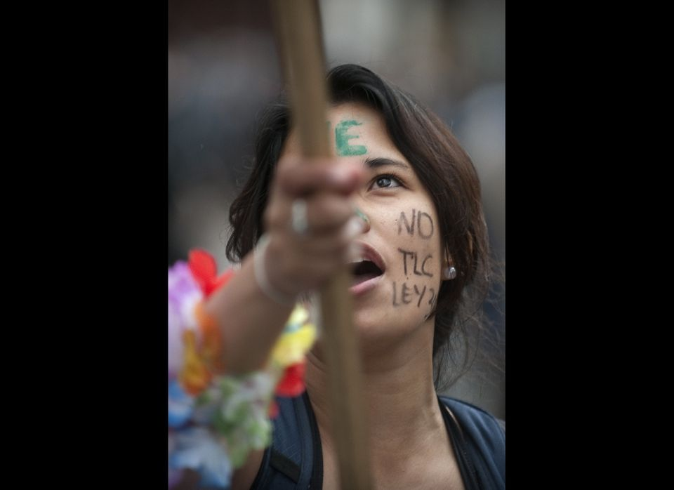 A student takes part in a protest against a reform on higher education, in Bogota on October 12, 2011. Thousands of students